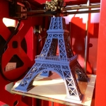 big builder with eiffel printing